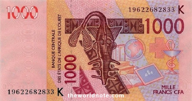1000 Francs CFA the front is  Catfish shaped brass weight of the Ashanti people for weighing gold dust, symbols of education and health