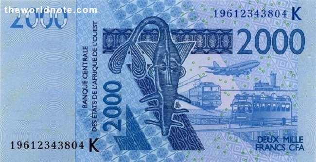 2000 Francs CFA the front is Catfish shaped brass weight of the Ashanti people for weighing gold dust, train, airplane, airport tower, bus